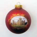 DOWNTON ABBEY® GLASS RED CASTLE BALL ORNAMENT © 2013 Carnival Film & Television Limited. All Rights Reserved